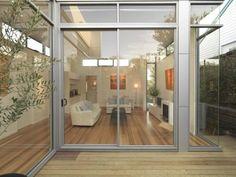 Aluminum sliding doors against timber