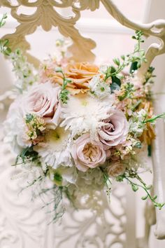 Mauve, peach and feather bouquet