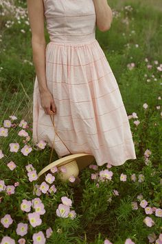 Pink 1950s cotton dress with a floppy straw hat. Photo by Nicole Mlakar.