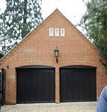 Love black garage doors on a brick detached garage