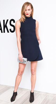Karlie Kloss in a navy Dior mini dress