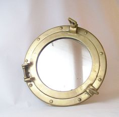 vintage porthole brass mirror wall hanging by RecycleBuyVintage, $110.00