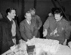 Boris Karloff in full costume, cutting his birthday cake. 1938