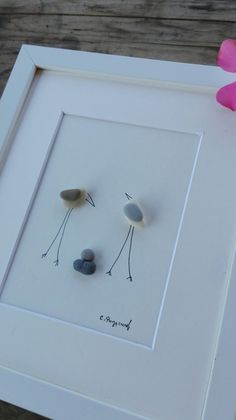 Pebble art Family This picture of the stones from the beach of the Adriatic shows a happy family pending a new member, the birth of a child ..   Colors are natural stone. Picture brings a beautiful harmony in your home, due to its simple composition and color.  Its a beautiful gift for childbirth, birthdays, anniversaries, weddings, moving into a house, apartment, etc.  If you buy 3 my pictures, you get a gift, gratis, another image that is not in my shop !!!   Size: 10x 8 inch / 25x20 cm…