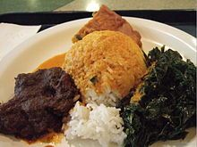 Rendang with rice+veggie. Rendang is a spicy meat dish which originated from the Minangkabau ethnic group of Indonesia