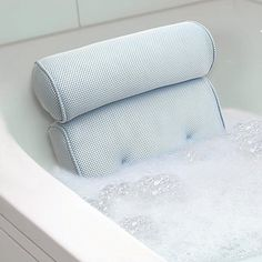 Soak away the stress and treat yourself to the ultimate bubble bath with this contoured bath pillow. Complete with suction cups to easily secure it, it's made of open-air fibers, which repels mold and mildew by allowing air and moisture to flow through it. Plus, the bolster neck rest softly cradles your head and supports your shoulders (perfect for reading in the tub!).