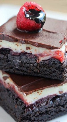 Chocolate Raspberry Brownies Recipe ~ Chocolate brownies layered with cream, raspberry jam and topped with semisweet chocolate. These decadent bars are the best of all worlds with a thin cream cheese layer and delicious raspberry jam.