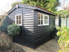 Superior Garden Shed Finished In Black Valtti Paint This 2.4 x 3.0m Superior Shed, in Black Valtti paint system, settles wonderfully into our customer's South London garden. The cedar shingle roofing contrasts against the Black Valtti paint as well as the Ivory Valtti windows, creating a garden building that is exceptionally distinctive
