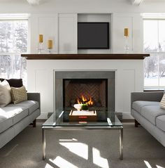 hidden tv above the fireplace.