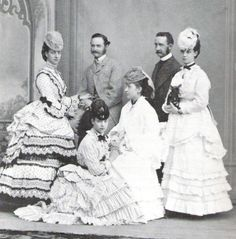 victorian3:  facesofthevictorianera:  The Danish Royal Family in the 1870s  This makes the third shot I've found taken while the sisters were wearing the same outfits.