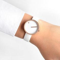 The Picto comes with a hardened mineral glass lens and a white rubber strap. #design #watches