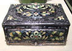 Elizabeth E. Copeland (United States, 1866 - 1957)  Covered Box, circa 1915  Metalwork, Silver and cloisonné enamel, 3 3/8 x 6 1/4 x 4 3/4 in. (8.57 x 15.88 x 12.07 cm)  Purchased with funds provided by the American Decorative Art 1900 Foundation and the Decorative Arts Deaccession Fund (M.2007.57)