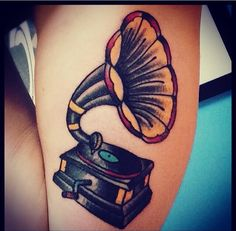 Dig the simplicity of this phonograph tattoo