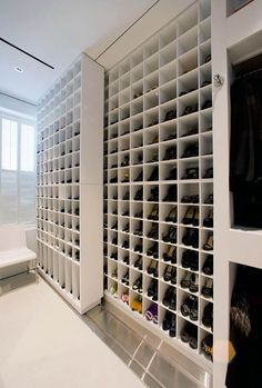 35 Beautiful Walk in Closet Designs Nice walk-in closet. It uses high-tech motion hardware. There are two color shades of shoe shelves in the room. The rest of the cabinet is also modern in design, with open white frames in plain white. Closet Shoe Storage, Shoe Shelves, Shoe Racks, Shoe Closet Organization, Shoe Organizer, Shoe Storage Luxury, Shoe Storage Design, Sliding Shelves, Basement Storage