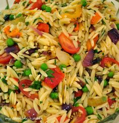 This orzo salad makes enough to feed a crowd and is perfect for entertaining because it can be made ahead and served at room temperature....