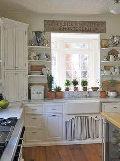 Vintage style open shelves surrounding kitchen window