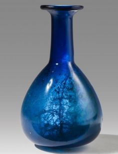 Roman Glass Bottle, 1st-2nd Century ADMore about this bottle and the history of ancient glass production… [[MORE]]The bottle is preserved intact presenting its glossy surface; signs of weathering are visible mostly inside the vessel. It is made of...