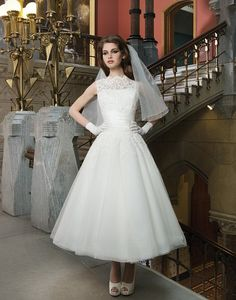 Keep it short on your wedding day with a lace tea length dress
