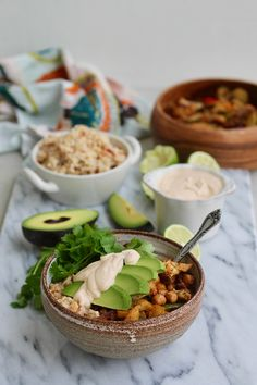 vegan sheet pan fajita bowls with zucchini, peppers, cauliflower, spicy chickpeas, and chipotle-lime cashew cream // themuffinmyth.com
