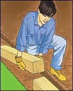 Step 2: Place the timbers of the first course in the trench and check the level of timber