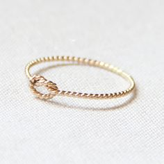 BACKORDERED - One Memory Knot Ring - Thread of Rope Gold Ring - Tiny Twist Textured Stacking Ring - Delicate Jewelry - Memory Ring. $10.75, via Etsy.