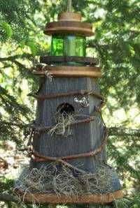 Enjoy nature in your backyard with a decorative rustic lighthouse birdhouse. This handcrafted birdhouse of recycled barnwood and pine will last for years. The birds love them and will come back year after year for your birdwatching pleasure. Dimensions: 14″H x 7.5″W x 10″L