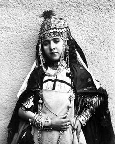 Africa | Portrait of a young woman in traditional dress. Algeria. ca. 1910 | Photographer unknown.