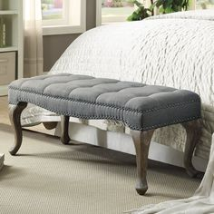 The Elya Upholstered Bedroom Bench has a chic, sophisticated design and style that will complement numerous areas of your home. The bench features a tufted top, silver brushed nailhead trim and curvy washed legs. Perfect for placing at the end of a bed, in a hallway or an entry, the bench provides sturdy, durable seating wherever it is placed.