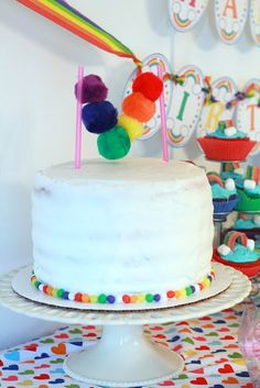Rainbow cake with a simple cute cake topper.