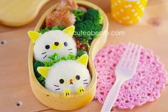 Cat bento - bento, is a style of elaborately arranged bento which features food decorated to look like people, characters from popular media, animals, and plants.