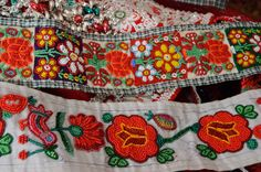 Beads, colour, embroidery and panels.