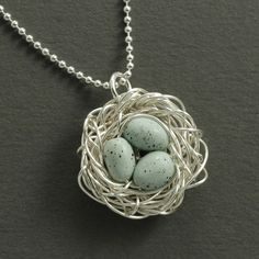 Bird Nest Necklace with blue robin eggs! I think I could do this with the wire, and then use clay to make the eggs...