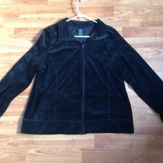 This is a black 100% polyester jacket by Faded Glory. It is a XXL. It is great condition. It collar can be worn as shown in the pictures or straight up. It has a zipper down the front . If you have any questions feel free to ask!