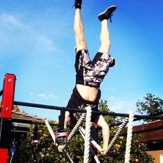 Handstand on 2 inch battle rope draped over the rack
