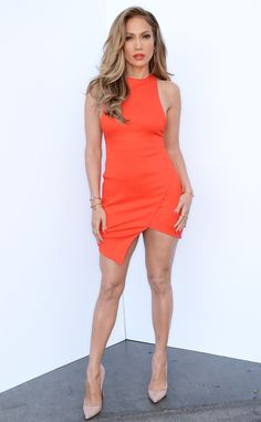 Jennifer Lopez ORANGE IS THE NEW BLACK The performer shows off her ample curves in this bright, body-hugging design.