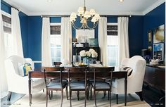 Love the dark wood, navy blue, and white. Plus armchairs at the heads of table.