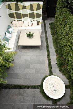 Modern garden design. Love the Mondo grass border contrasting the grey paving stone.