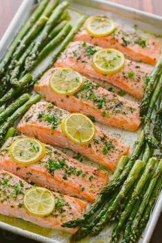 One-Pan Salmon Asparagus recipe with a lemon-garlic-herb butter. Every bite is so juicy and flavorful! A reader favorite, 20-minute salmon dinner.