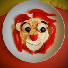 Make an animal out of hummus and veggies. We bet your kids will roar for more!