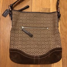 Coach brown and tan cross body. Coach brown and tan cross body. Used good condition. Suede bottom. A few marks. Coach Bags Crossbody Bags