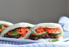 Filipinio Adobo Pork Belly (cooked sous vide) Steam Buns with Sweet and Sour Carrot Slaw, courtesy of Camille In The Kitchen blog.