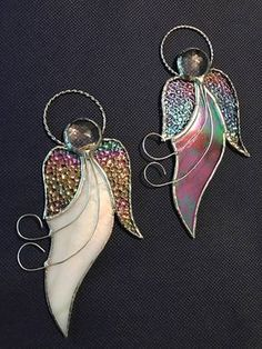 Pricing is for 1 Angel. Christmas Angels, Stained Glass Ornaments This beautiful Angel is approximately 2 1/2 x 6 1/2 in size. It has been created using stained glass, glass facetted jewels for the head, iridized glass wings and a braded halo. This photo shows different glass used. The white is an Iridescent opaque white and the second angel is a clear iridescent baroque glass with texture and reflections. Each angel will have the same components but with different textures of gl...