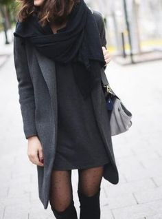 Trendy brunette in dark grey woolen dress and long grey coat