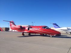 Sleek red paint job on this lear jet. From redditor ok2010