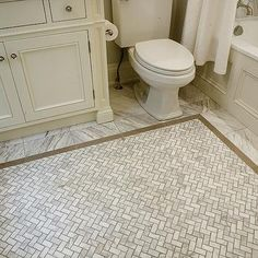Stunning bathroom with ivory vanity beside toilet and wainscoting paneled tub with marble tiled floors framing a marble basketweave tiled rug. Floor might work -- small herringbone style tiles Shower Floor Tile, Bathroom Floor Tiles, Bathroom Fixtures, Kitchen Tile, Marble Herringbone Tile, Marble Mosaic, Marble Floor, Shower Bath Combo, Bath Shower