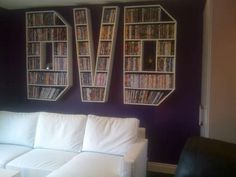 """This is both practical and artistic. i like how the lettering of the word """"DVD"""" pops out from the background, and how it conveys it idea. the case is made for DVDS by a case made up of the letters. the contrast of the wall and couch also make it have depth, and balance, or else the picture will be too dull."""