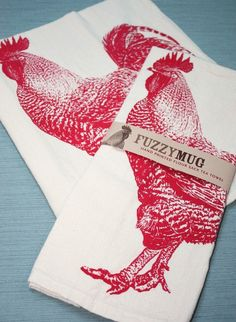 We like the idea of adding a contemporary twist to a country kitchen with this red rooster tea towel.