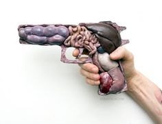 Noah Scalin calls to question the violent nature of war by combining human biology and guns.
