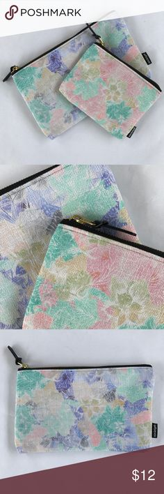 "Set of two Printed Carry-All Pouches Two canvas carry all pouches featuring a soft floral print in blush, mint and periwinkle colors. Perfect for a gift. Never used and still in poly bags. Small pouch measures 6.5"" x 5"" and medium pouch measures 9.5"" x 6"". Gold YKK zipper Society6 Bags Cosmetic Bags & Cases"