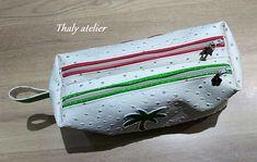 Trousse Zip-Zip en simili autruche blanc cousue par Thaly - Patron Sacôtin